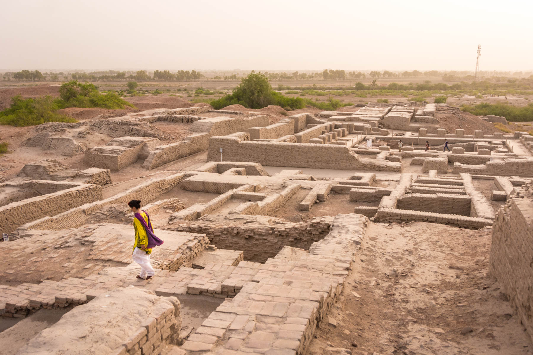 Pakistan bucket list - Girl exploring Moenjodaro ruins in Sindh - Lost With Purpose travel blog