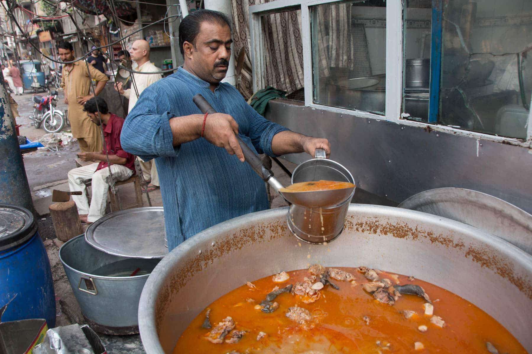 Pakistan bucket list - Man making soup in the walled city of Lahore - Lost With Purpose travel blog