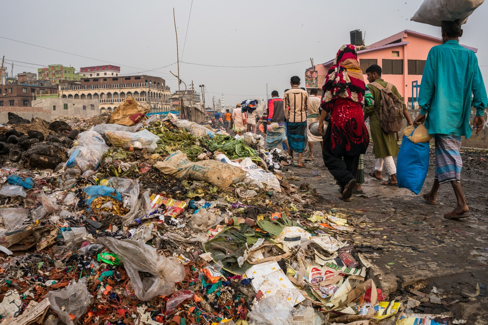 Reverse culture shock from long-term travel - Piles of trash on the streets of Dhaka, Bangladesh - Lost With Purpose travel blog