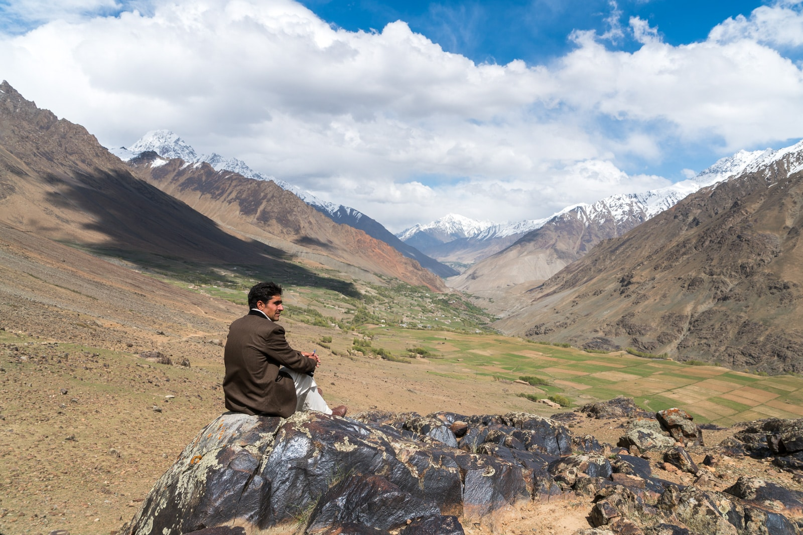 Phander Valley travel guide - Man sitting on a rock overlooking Teru - Lost With Purpose travel blog