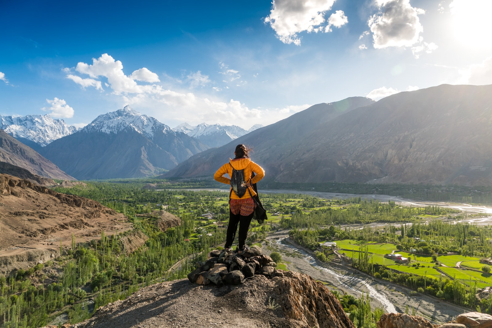 Reverse culture shock from long-term travel - Standing on a rock overlooking Yasin Valley in Gilgit Baltistan, Pakistan - Lost With Purpose travel blog