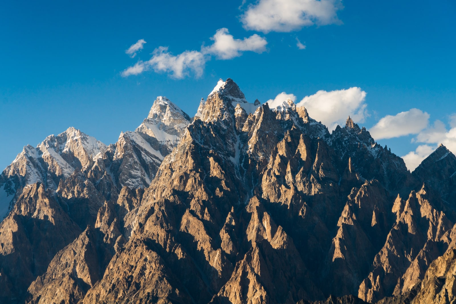 Homestay in Pakistan - Passu cones at sunset in Gilgit Baltistan - Lost With Purpose travel blog