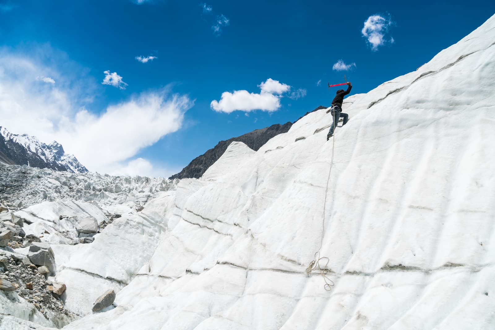 Homestay in Pakistan - Rehman ice climbing on the white glacier in Gilgit Baltistan - Lost With Purpose travel blog