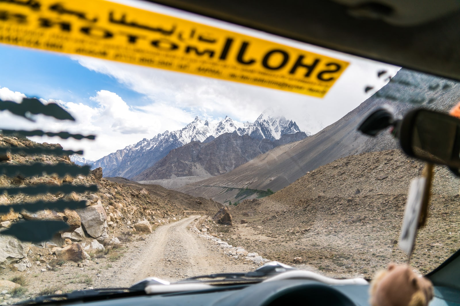 Homestay in Pakistan - Rehman driving to the white glacier - Lost With Purpose travel blog