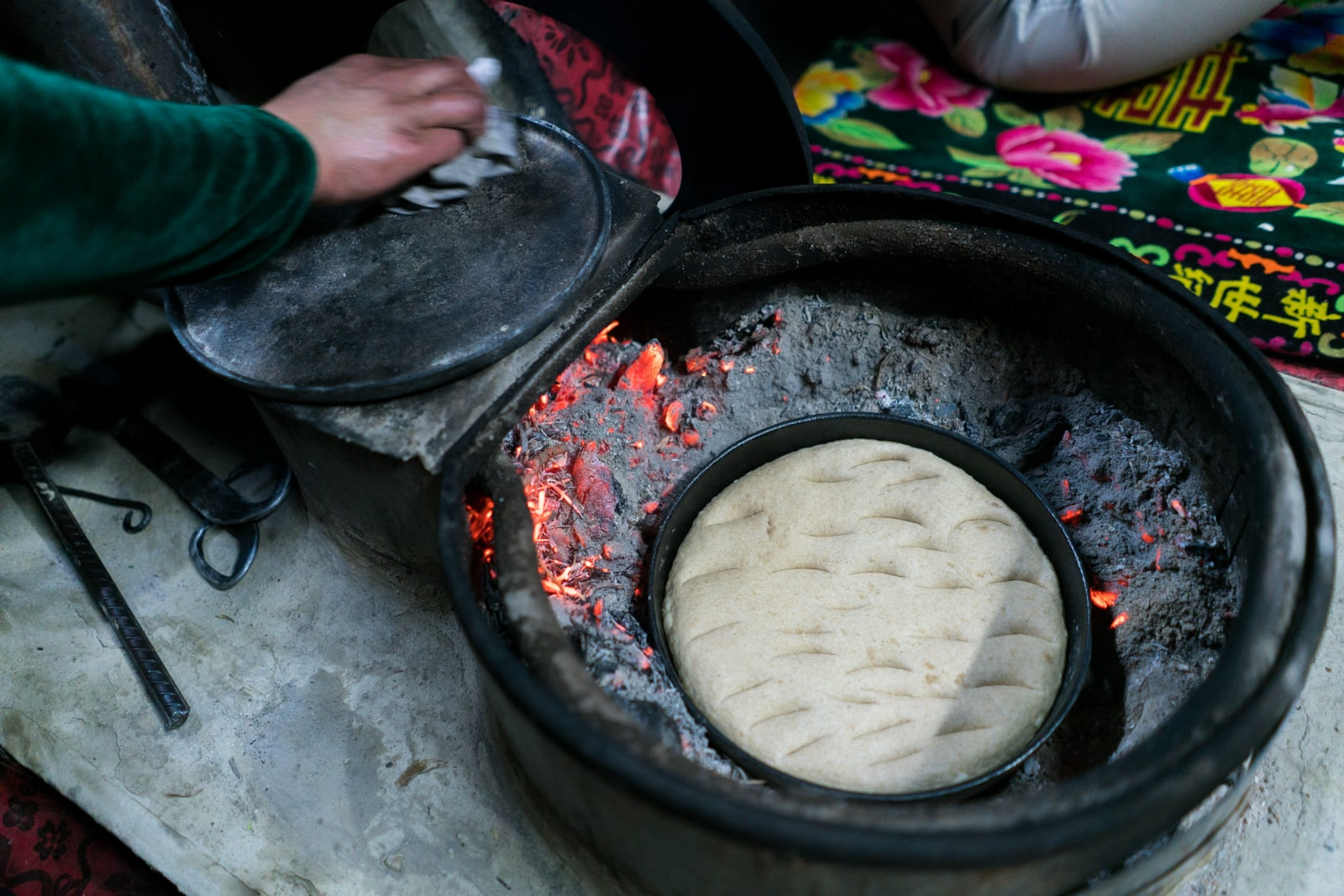 Homestay in Pakistan - Bread baking in the fire - Lost With Purpose travel blog