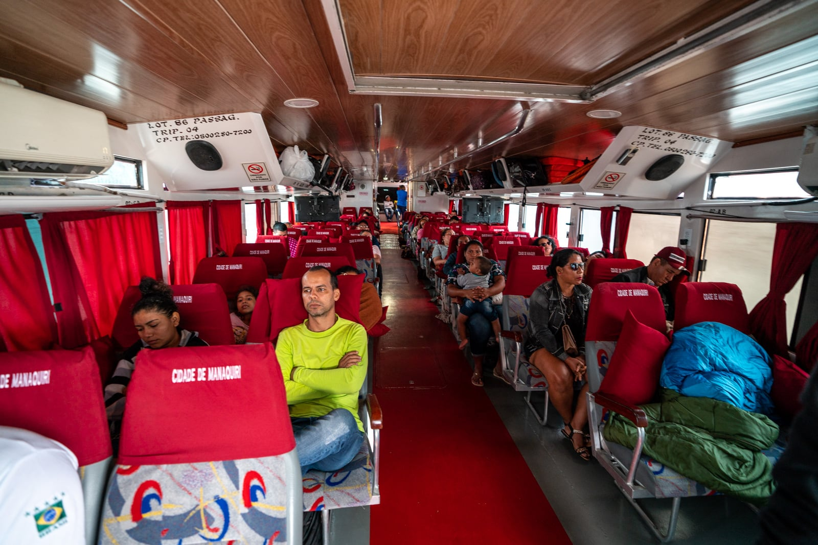 Taking the fast boat from Manaus, Brazil to Leticia, Colombia - Interior of the fast boat - Lost With Purpose travel blog