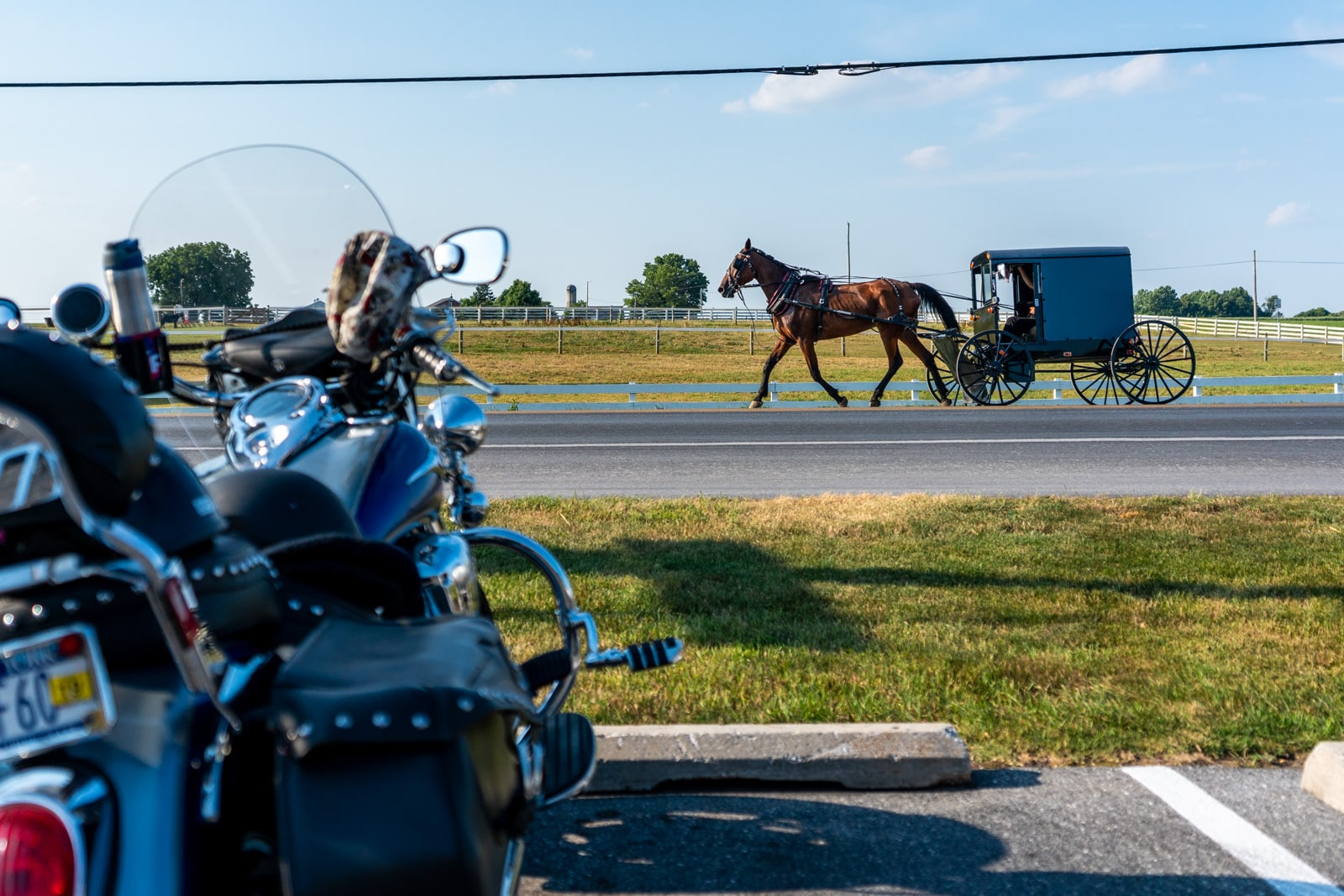Reverse culture shock from long-term travel - Amish horse cart driving past a motorbike - Lost With Purpose travel blog