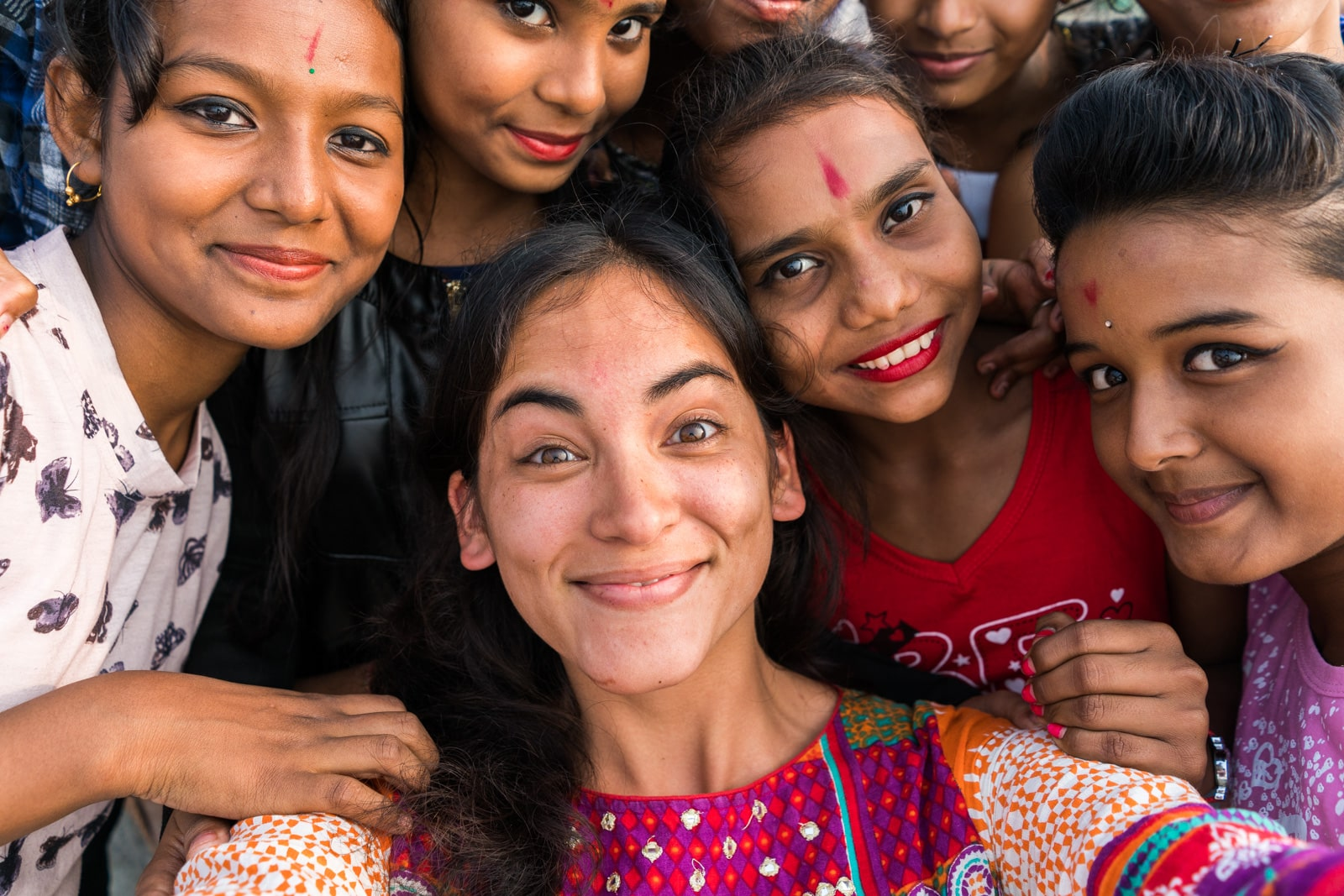 Reverse culture shock from long-term travel - Selfie with girls in Assam, India - Lost With Purpose travel blog