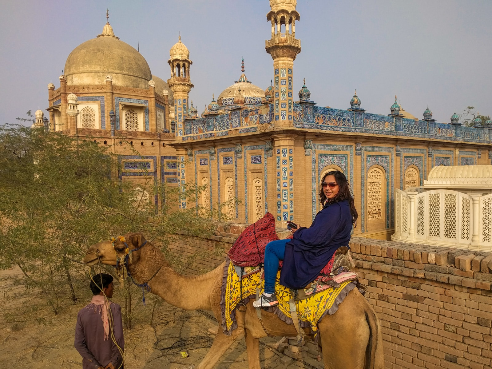 Bossy travelers interview with Aneeqa, head of Pakistan's first female-run tour company - Aneeqa on a camel in Multan, Sindh, Pakistan