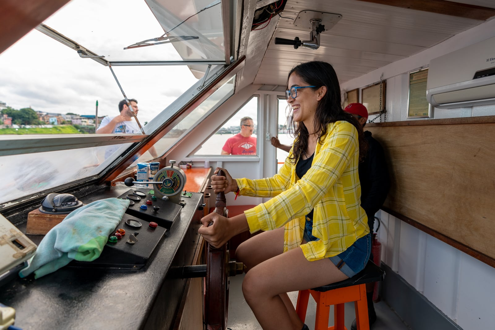 How I afford full-time travel - Driving a boat into Manaus, Brazil in the Amazon - Lost With Purpose travel blog