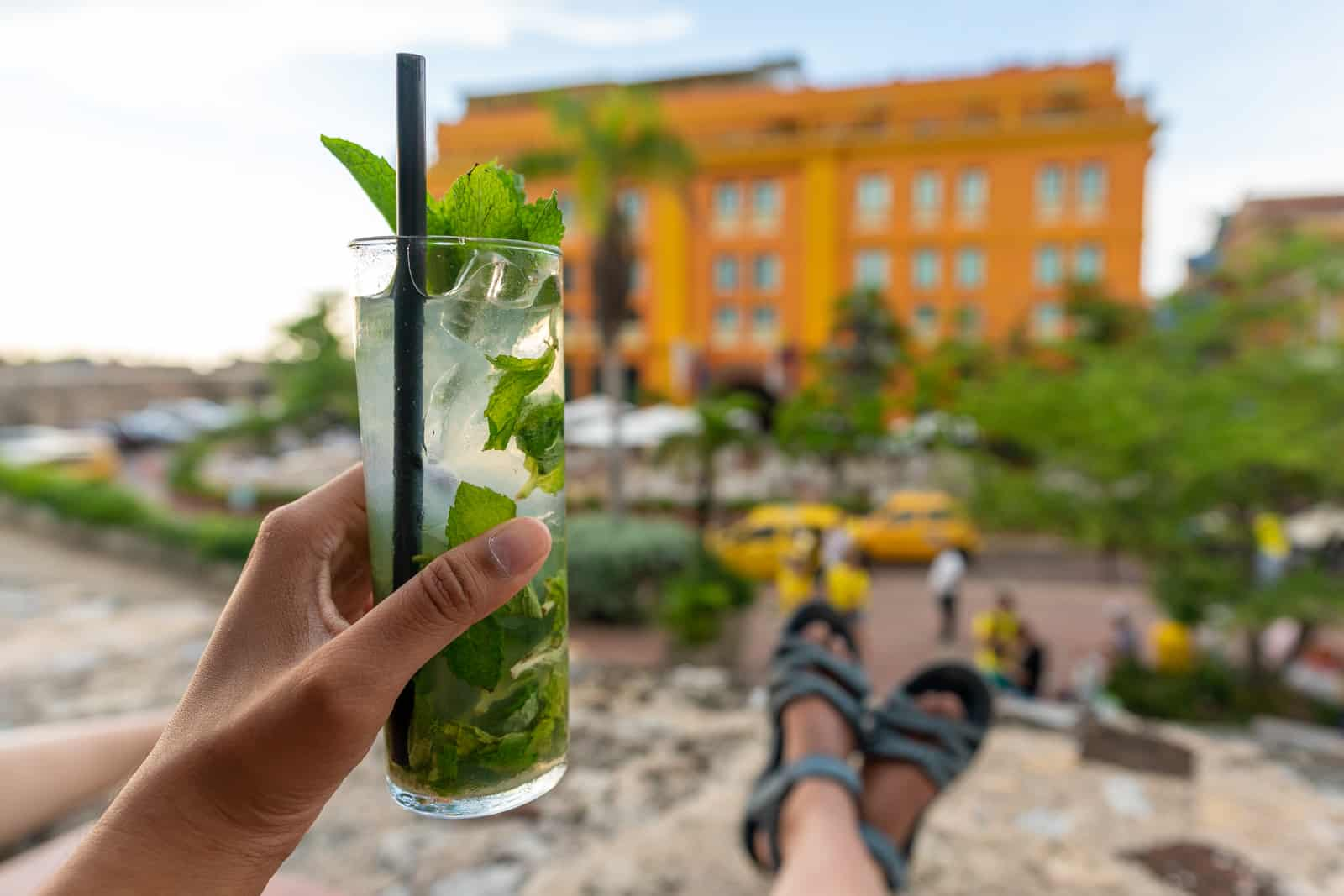 Cafes with wifi for digital nomads in Cartagena, Colombia - Happy hour drinks on a terrace at sunset - Lost With Purpose travel blog