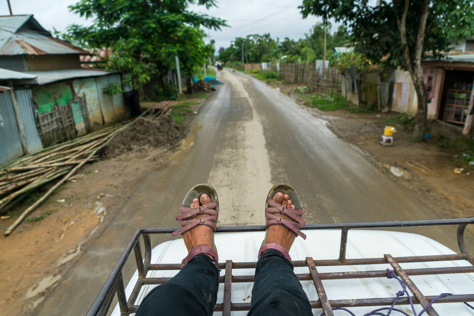 How I afford full-time travel - Riding atop a van in Manipur, India - Lost With Purpose travel blog