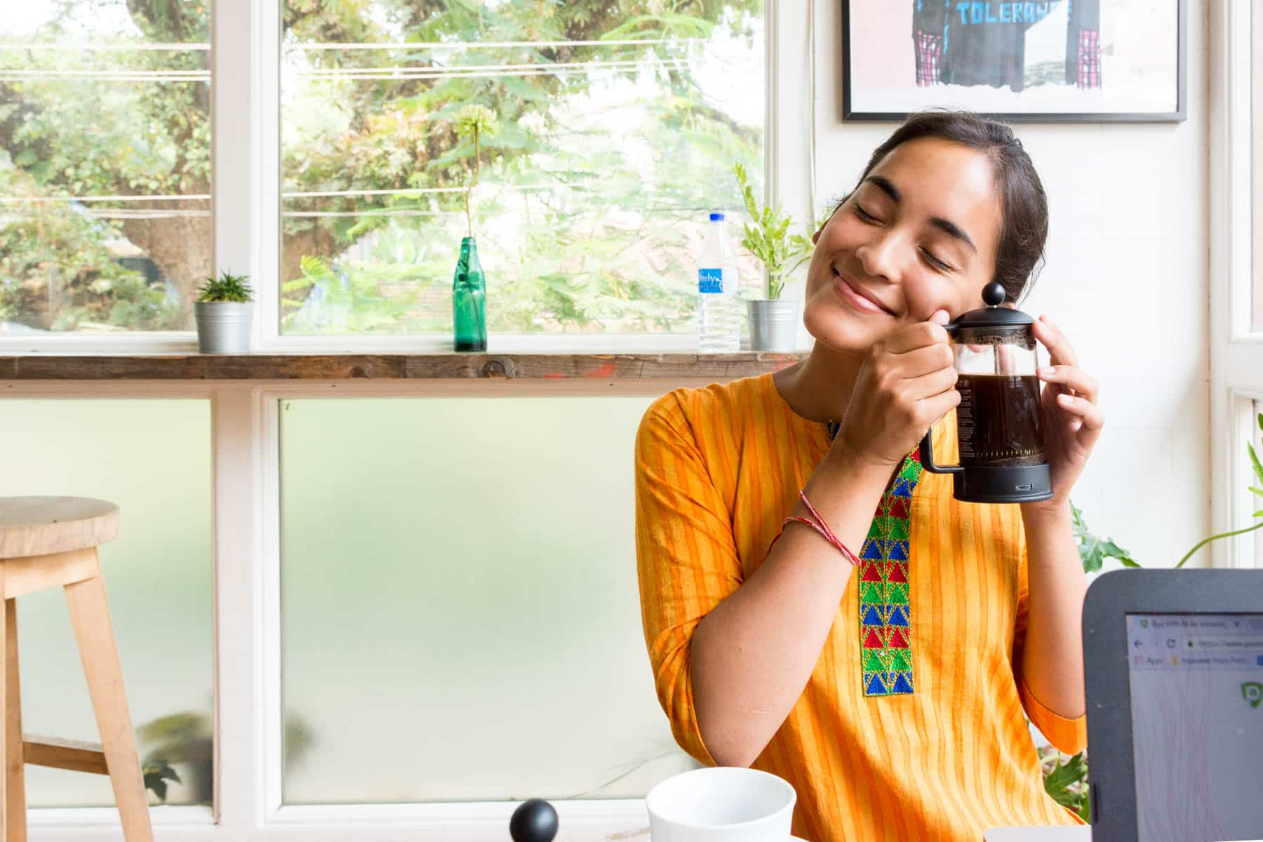 How I afford full-time travel - Alex with a french press of coffee in Fort Cochin, India - Lost With Purpose travel blog