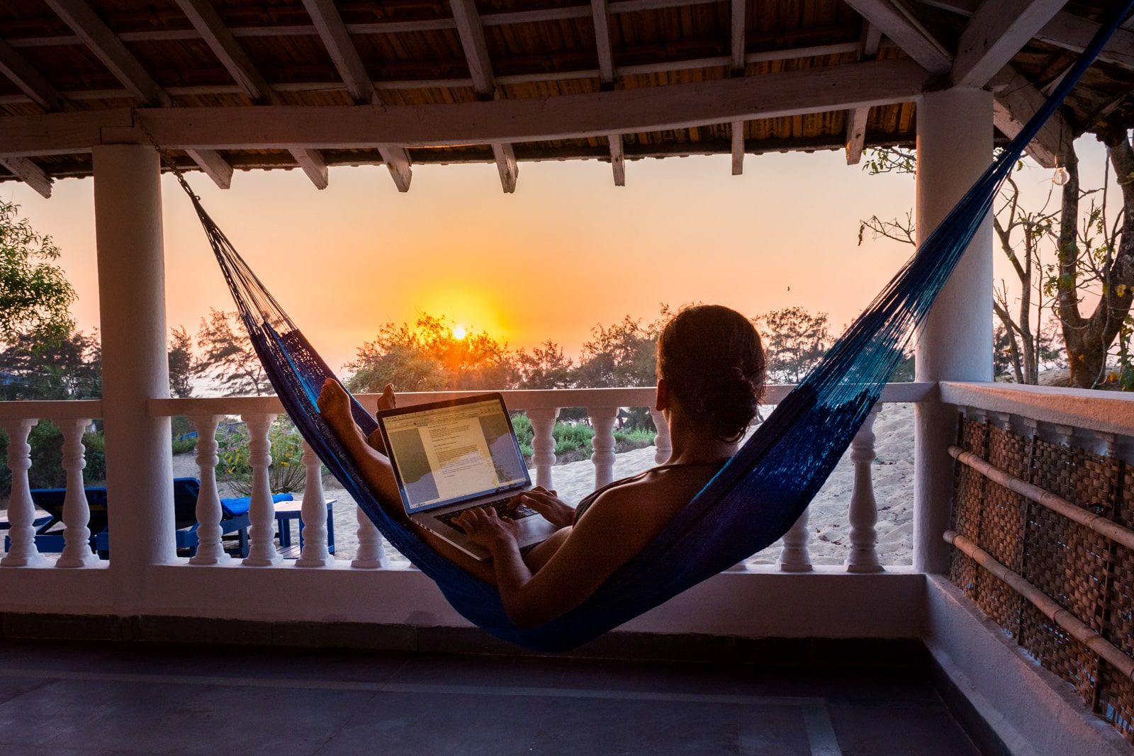 How I afford full-time travel - Working during sunset in Baga, Goa, India - Lost With Purpose travel blog
