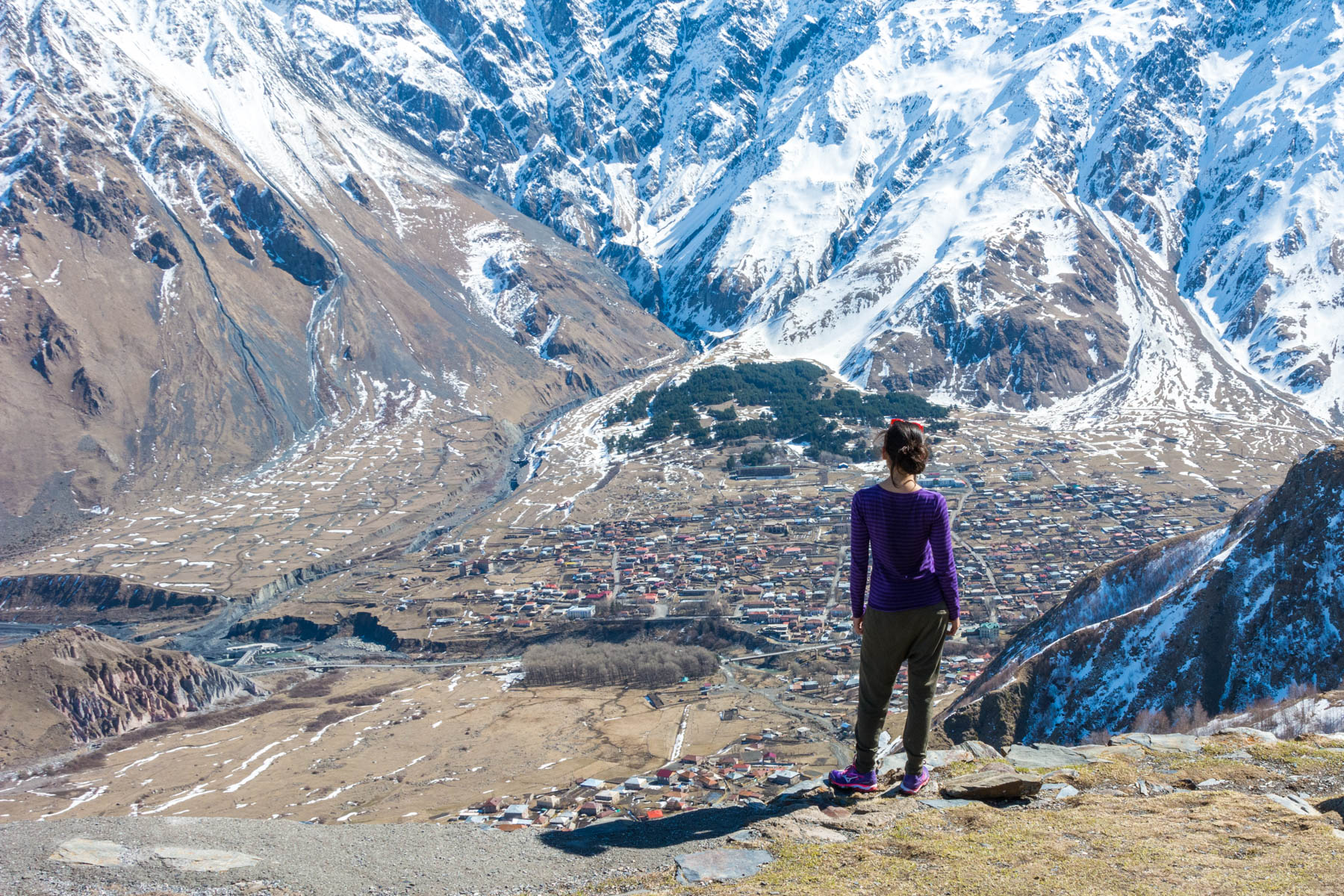 How I afford full-time travel - Alex admiring the view of Kazbegi, Georgia in 2016 - Lost With Purpose travel blog