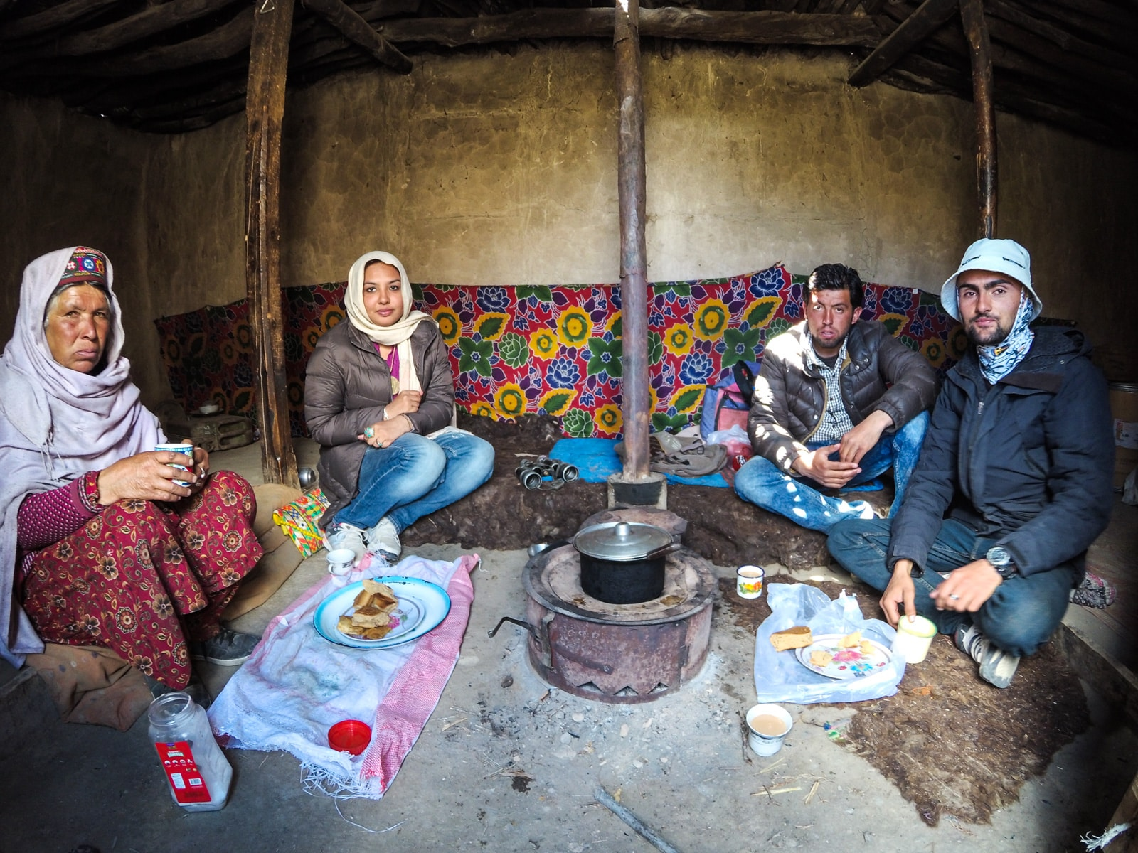 Bossy travelers interview with Aneeqa, head of Pakistan's first female-run tour company - Aneeqa with a local family in Hunza