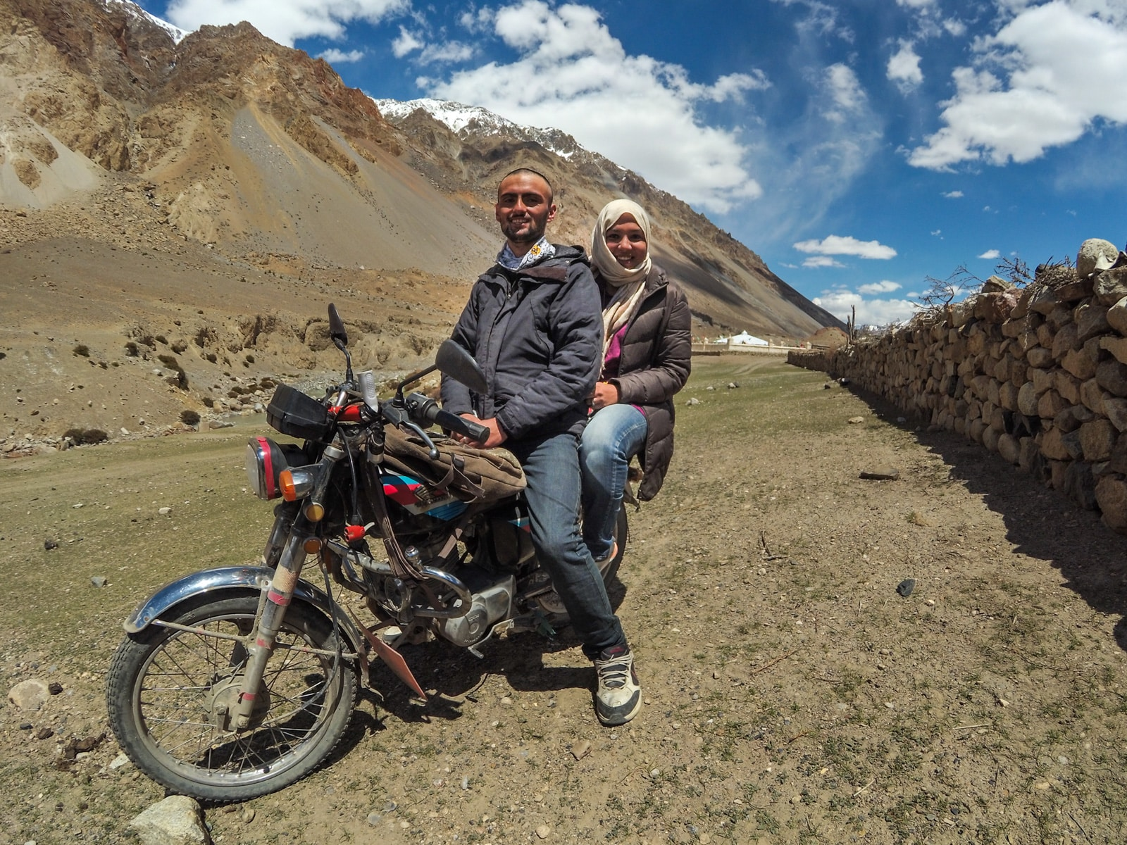 Bossy travelers interview with Aneeqa, head of Pakistan's first female-run tour company - Aneeqa on a motorbike in Gilgit Baltistan