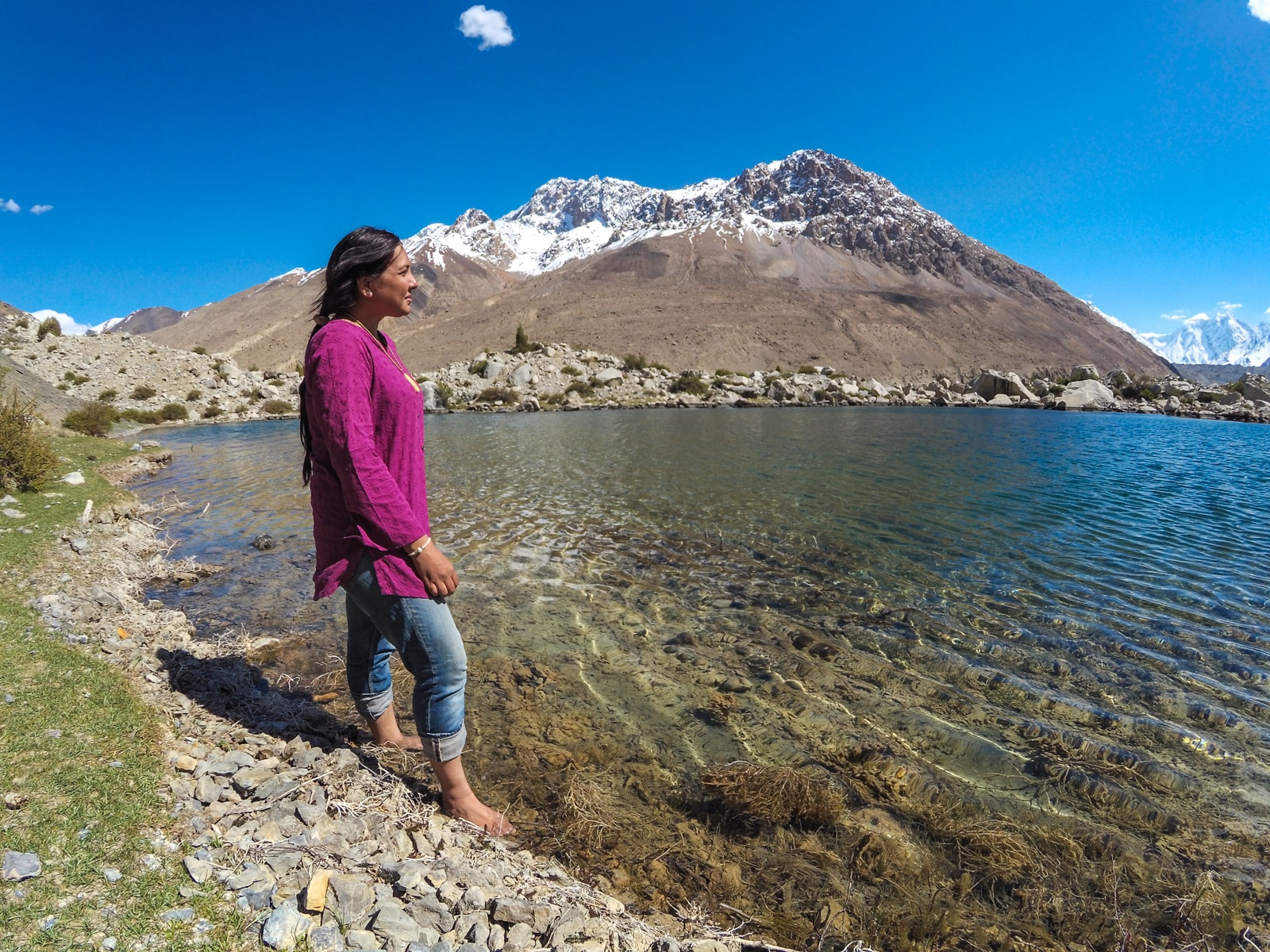 Bossy travelers interview with Aneeqa, head of Pakistan's first female-run tour company - Aneeqa at a lake in Gilgit Baltistan