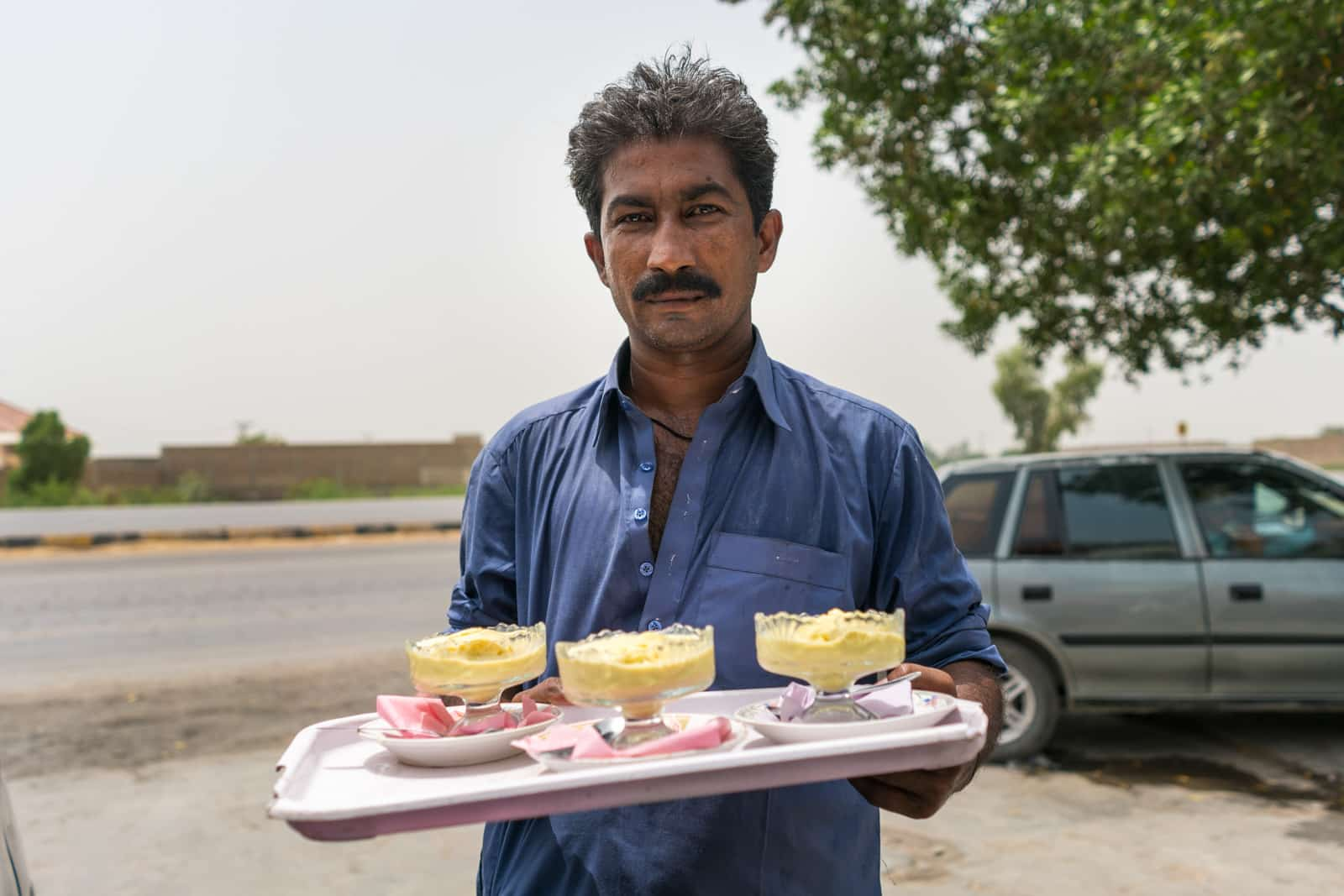 Sindh travel guide - Man serving ice cream in Matiari town - Lost With Purpose travel blog