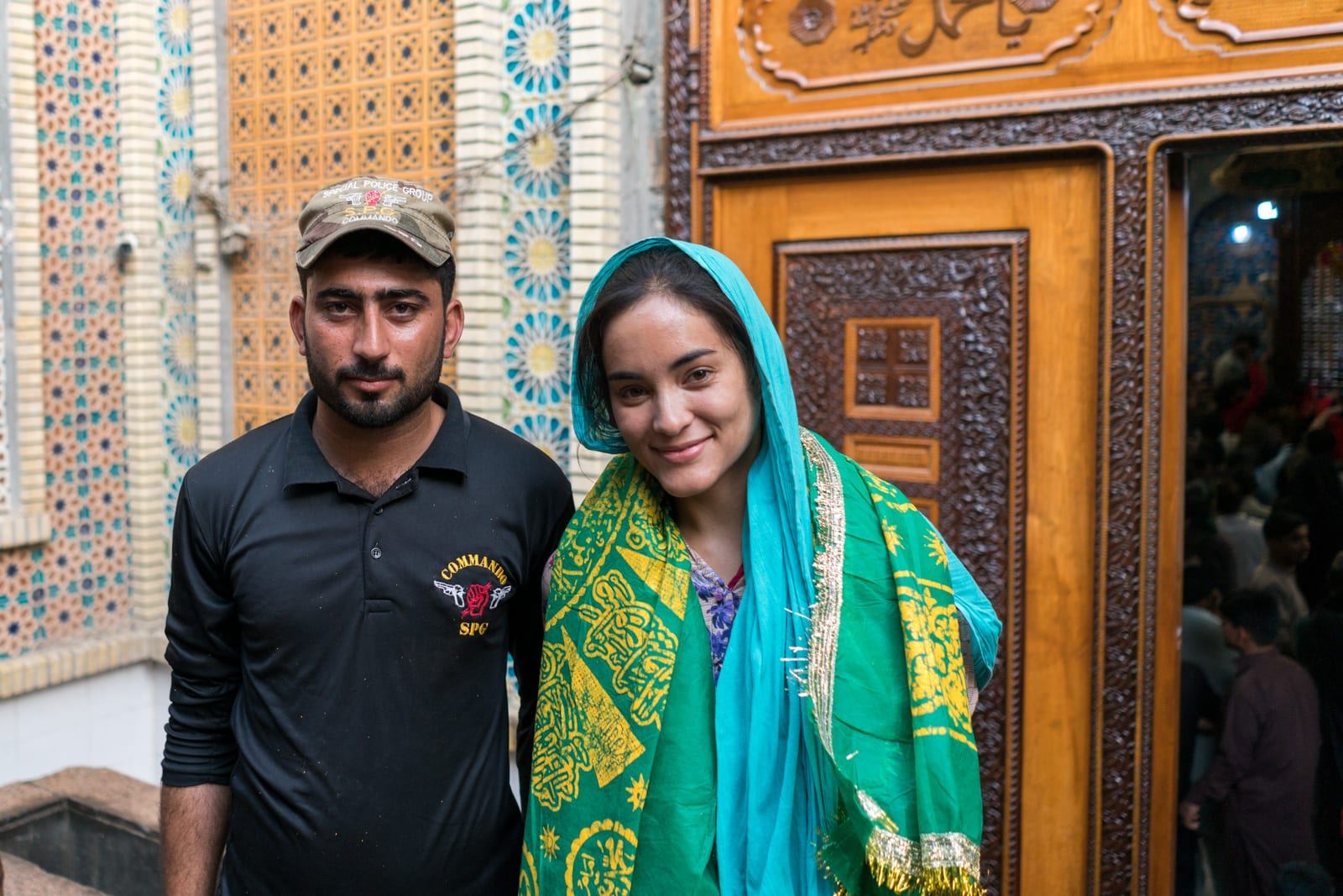 Sindh travel guide - With security guard at urs of Lal Shahbaz Qalandar in Sehwan Sharif, Pakistan - Lost With Purpose travel blog