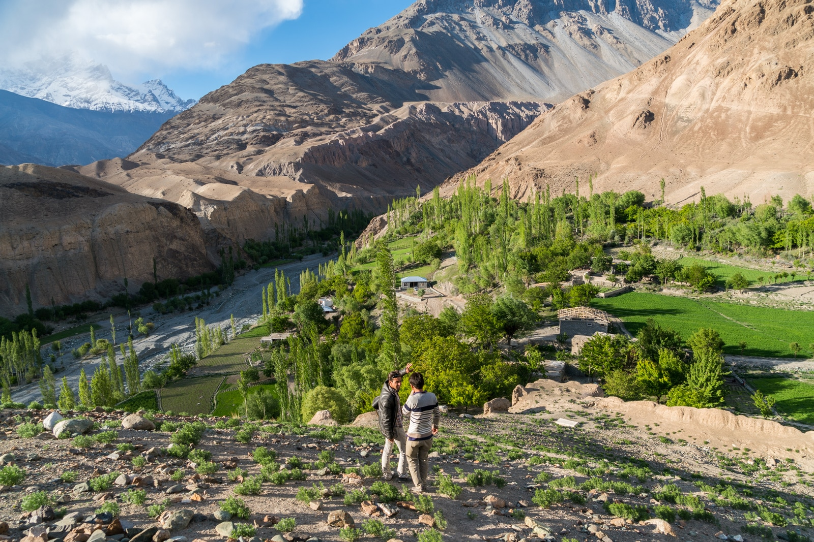 Ways to get more off the beaten track while traveling - Setting sun as boys climb a mountain in Yasin Valley, Pakistan - Lost With Purpose travel blog