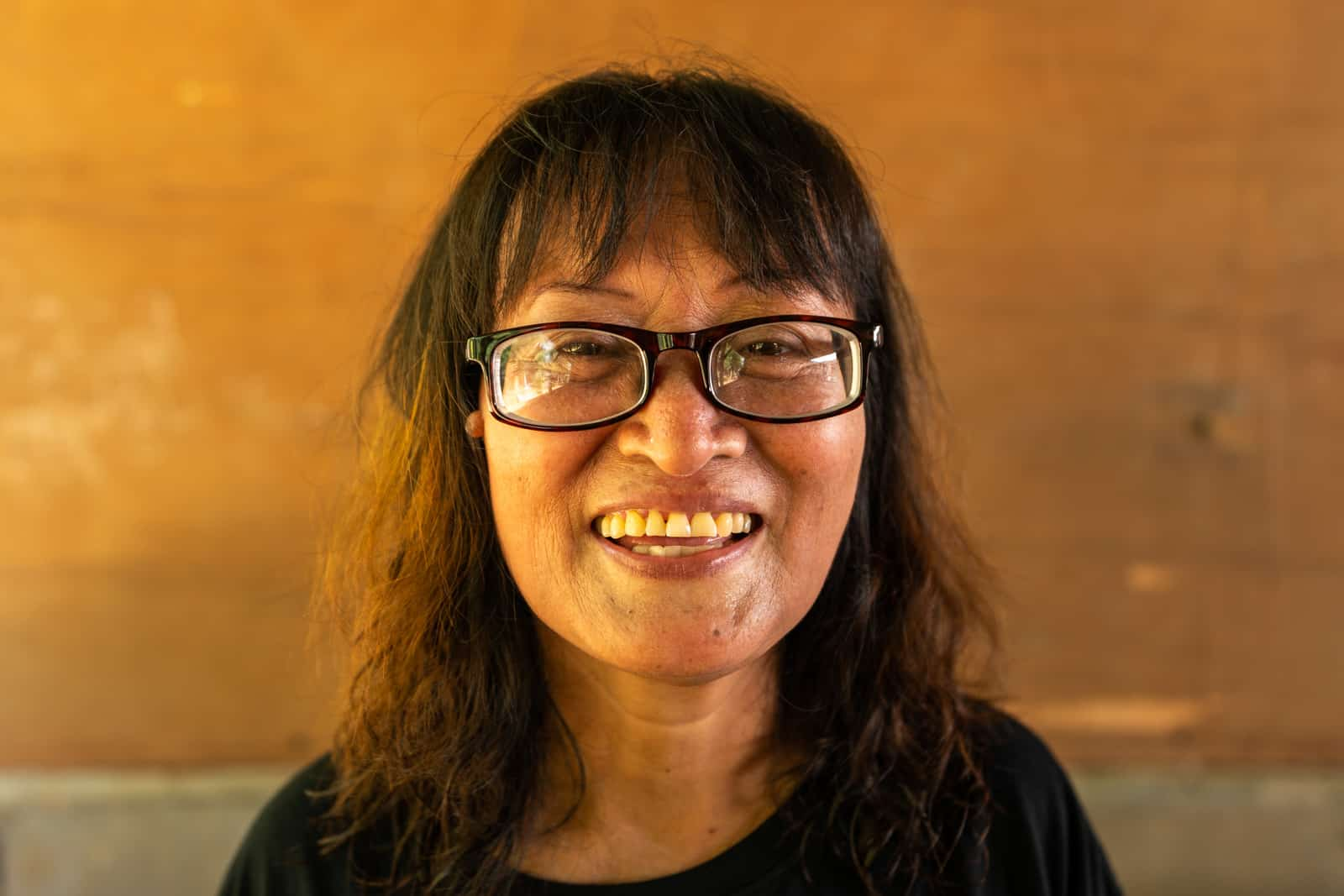 OneSight eye care clinic on the Thailand-Myanmar border - Nurse with new glasses - Lost With Purpose travel blog