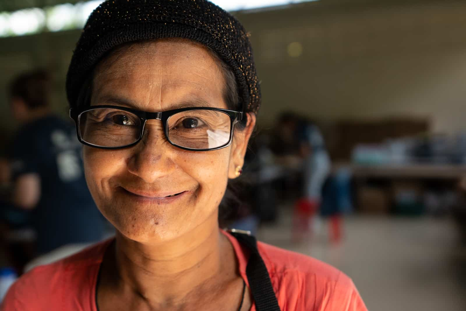 OneSight eye care clinic on the Thailand-Myanmar border - Woman with new glasses at Mae Tao Clinic - Lost With Purpose travel blog