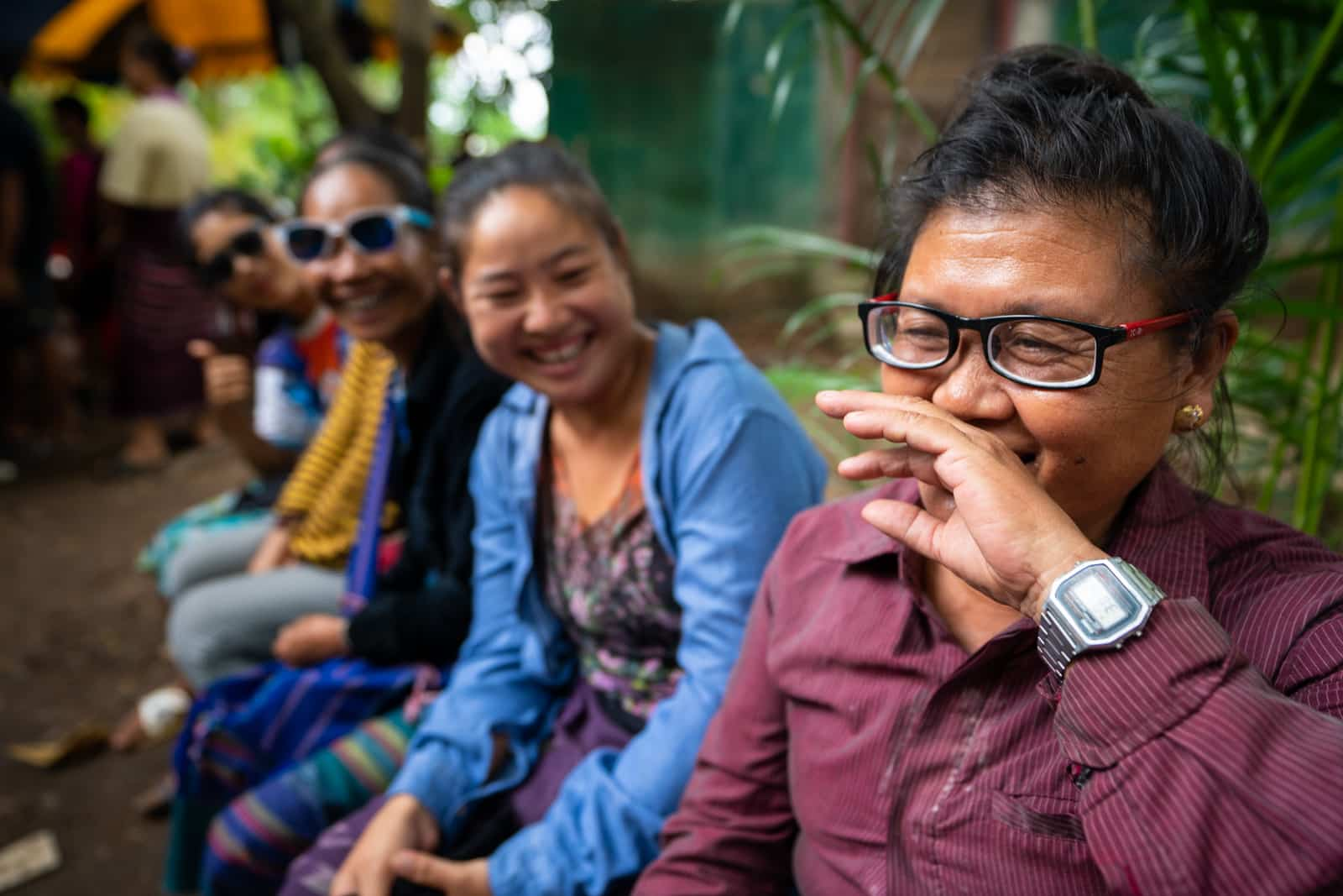 OneSight eye care clinic on the Thailand-Myanmar border - Woman with glasses laughing and smiling - Lost With Purpose travel blog