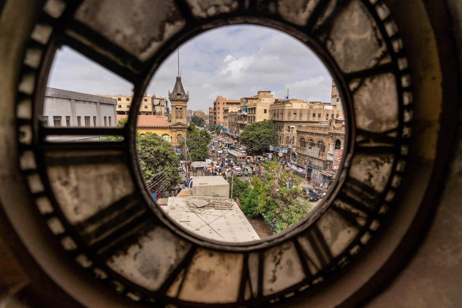 Ways of getting off the beaten track while traveling - View of Karachi through an old clock in Denso Hall - Lost With Purpose travel blog