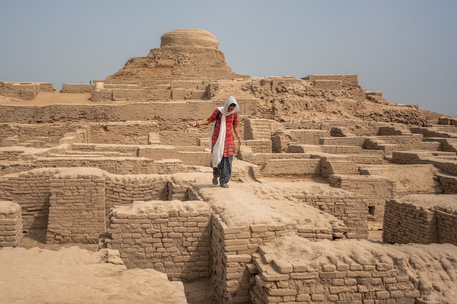 Sindh travel guide - Alex walking on the ruins in Moenjo Daro - Lost With Purpose travel blog