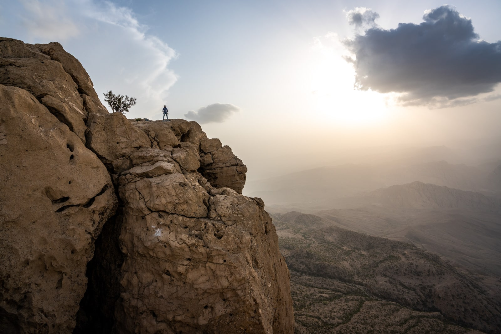 Sindh travel guide - Sunset at Gorakh Hill Station with boy standing on a cliff - Lost With Purpose travel blog