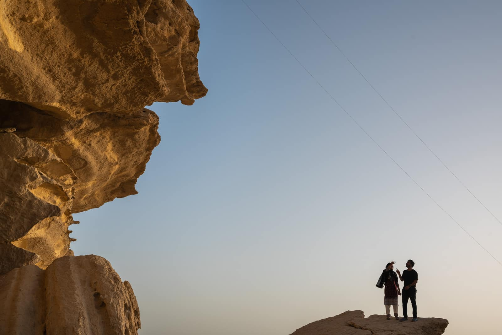 Sindh travel guide - Two people on a rock in Sindh, Pakistan - Lost With Purpose travel blog