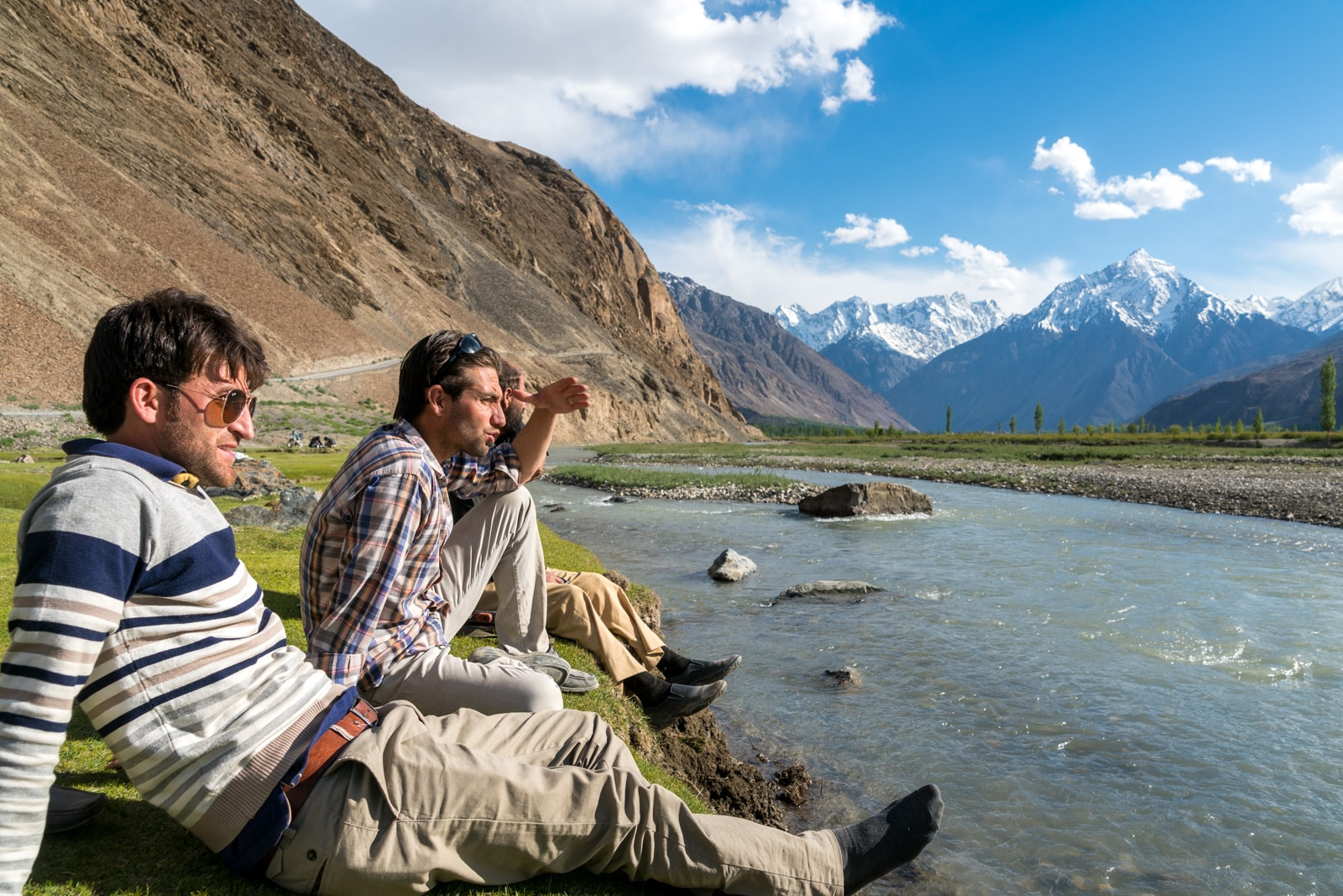 Reflections - Boys sitting next to a river in Yasin Valley, Pakistan - Lost With Purpose travel blog