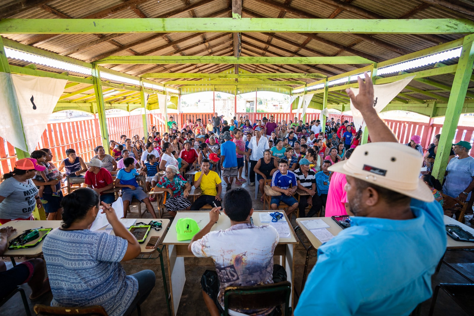 Reflections - Patients waiting their turn at a OneSight eye clinic in Cuia, Brazil - Lost With Purpose travel blog