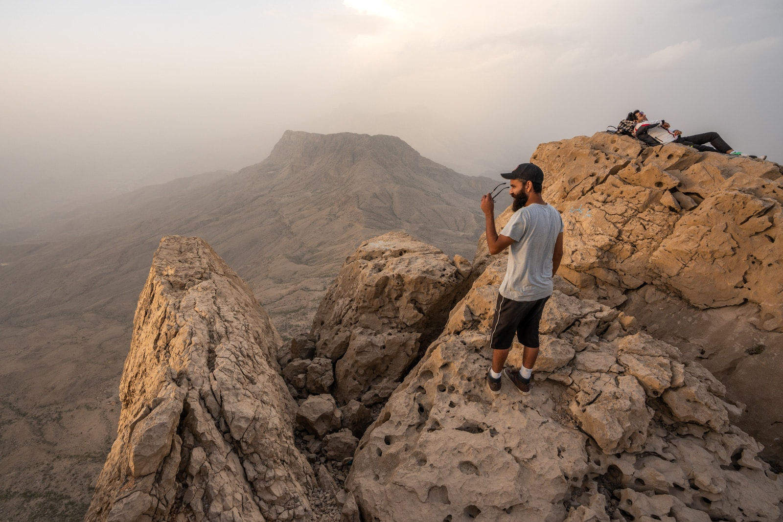 Reflections - Acid trip sunset over Gorakh Hill, Pakistan with boys on the rocks - Lost With Purpose travel blog