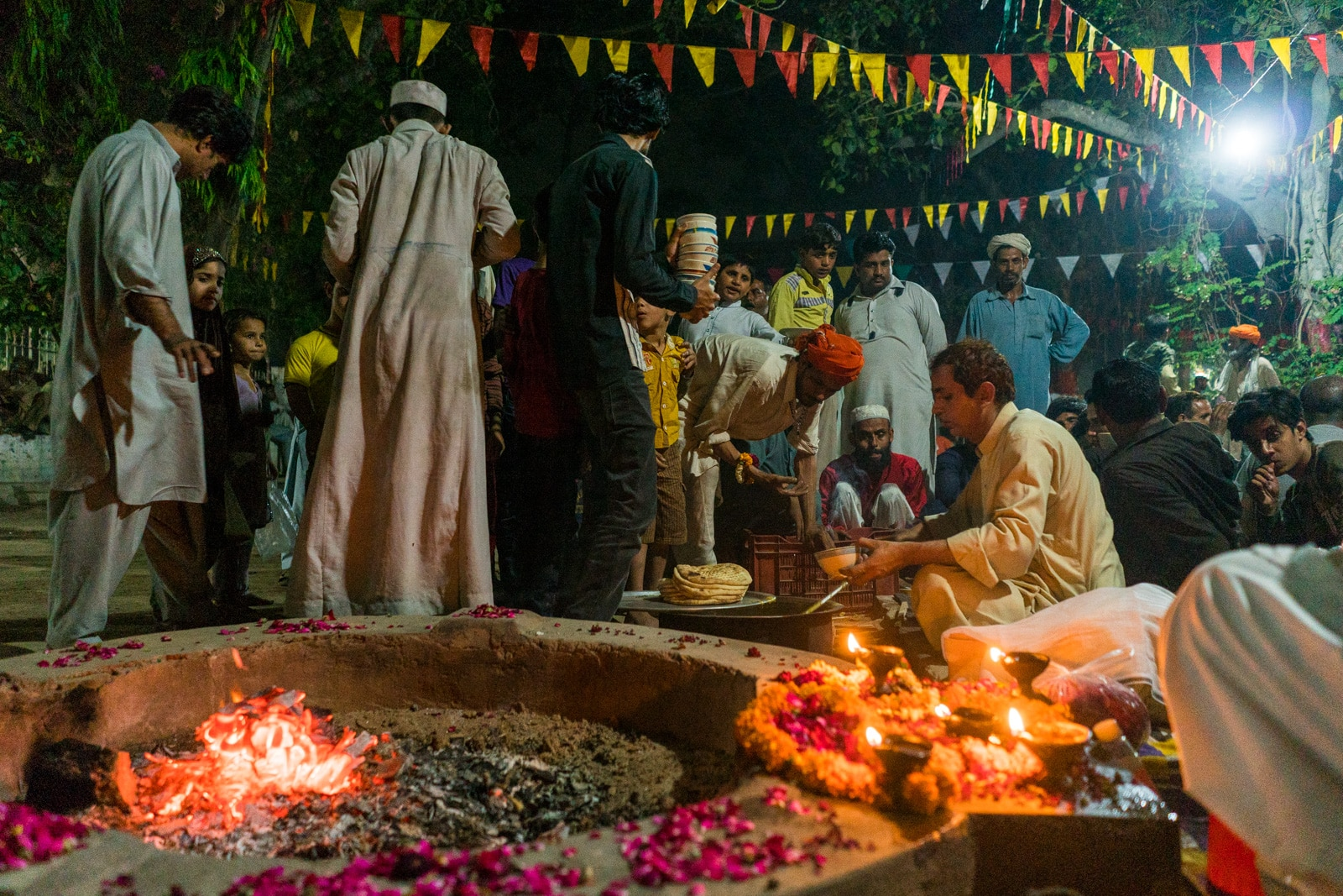 Sufi dhamal in Lahore, Pakistan - Man serving langar meal at the shrine of Madhu Lal Hussain - Lost With Purpose travel blog