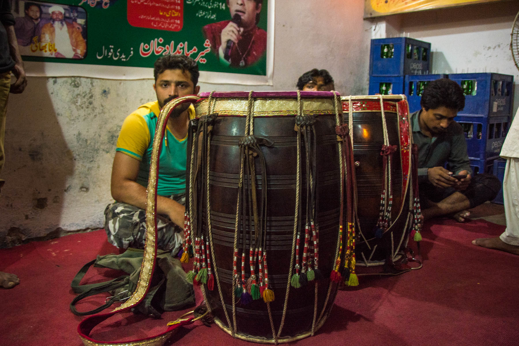 Sufi dhamal in Lahore - Dhol drums and drummers waiting to play at Shah Jamal shrine - Lost With Purpose travel blog