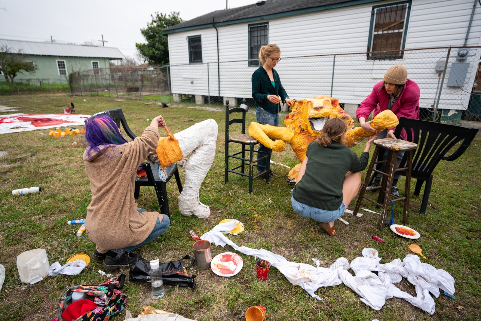 Painting a plaster lioness for a Mardi Gras parade in New Orleans, LA