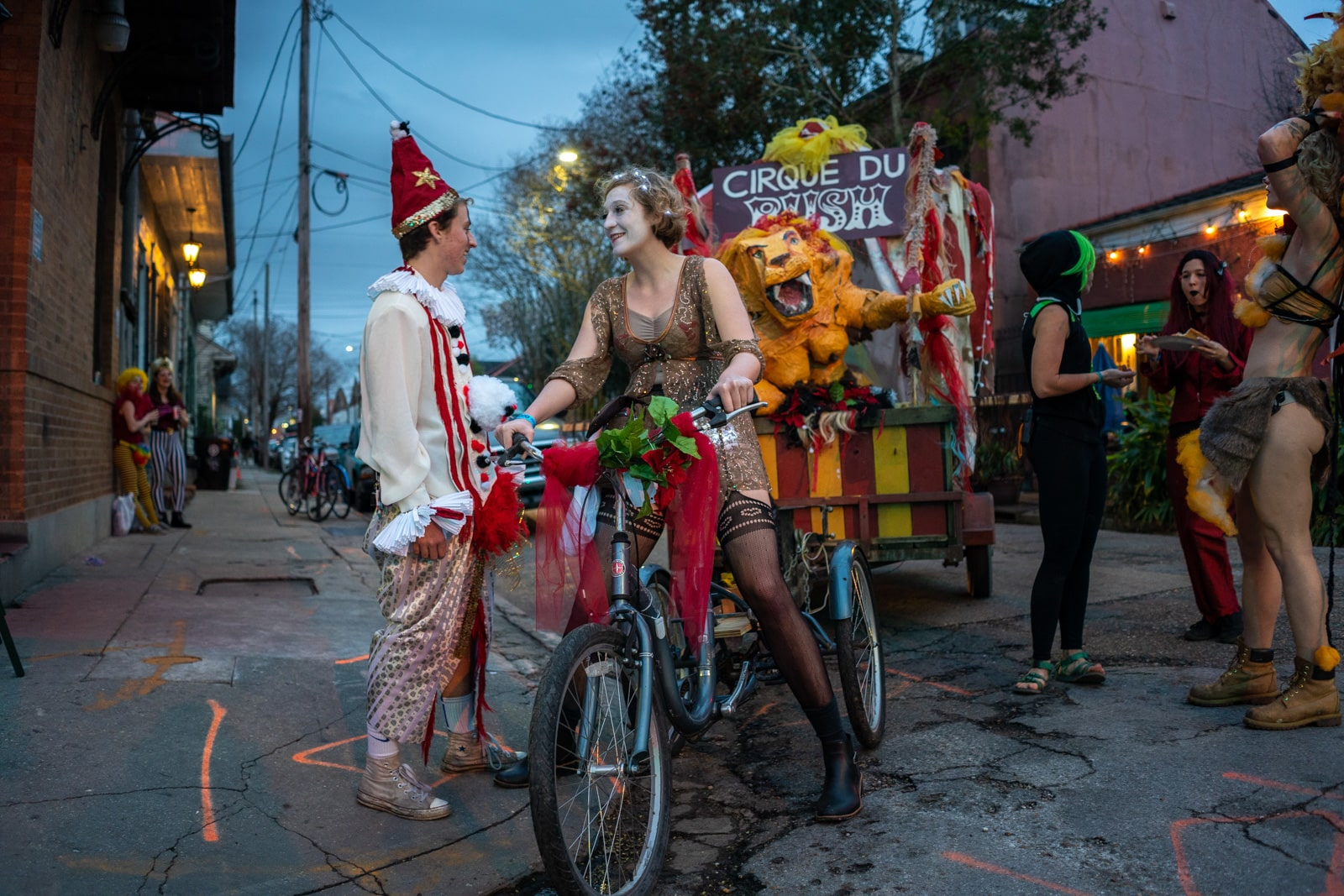 Paraders in circus costumes with a float during Mardi Gras in New Orleans