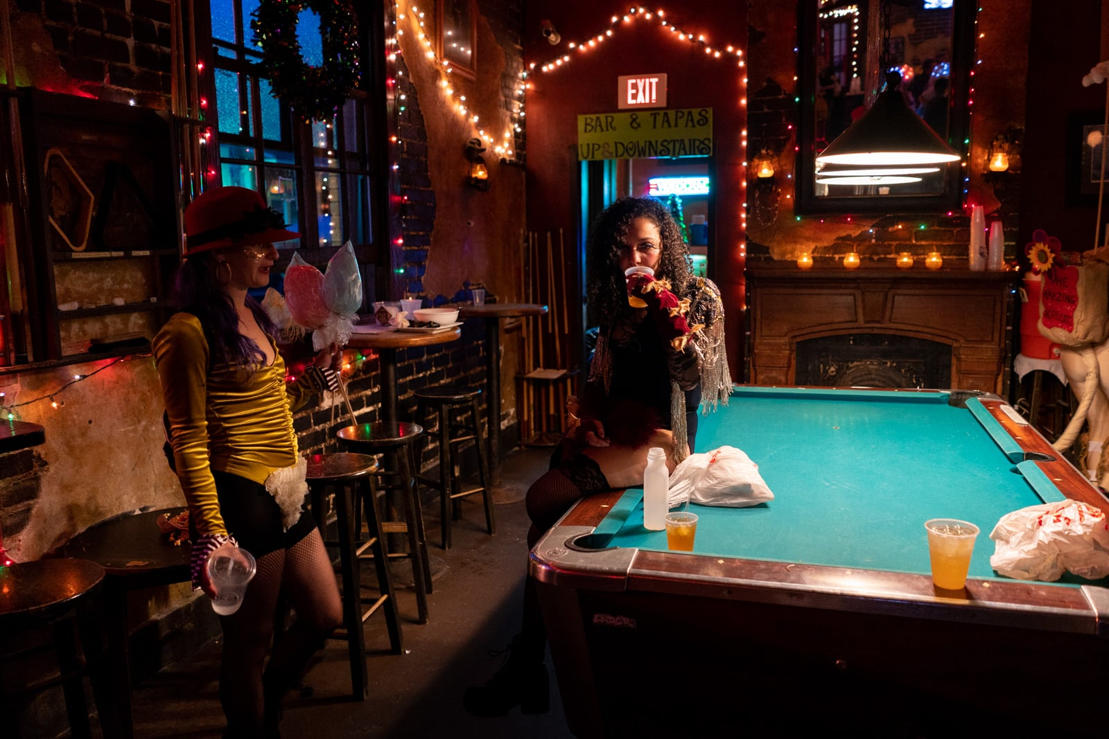 Girls drinking on the pool table at Mimi's in the Marigny in New Orleans