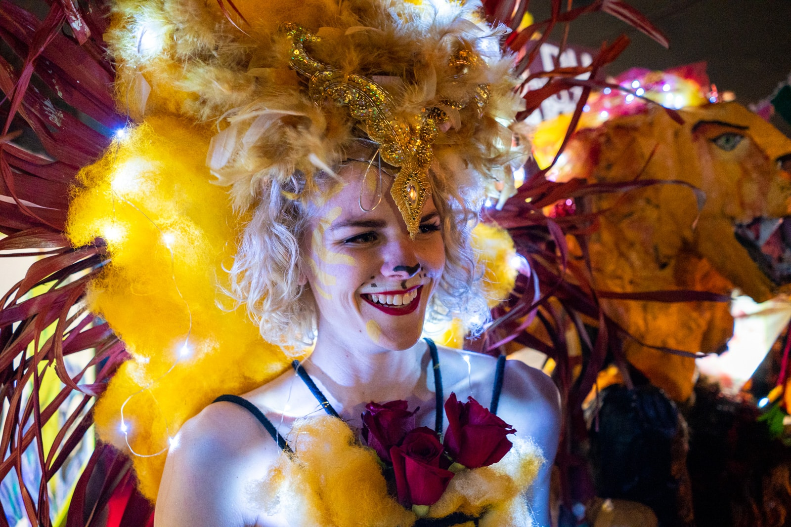 Girl dressed as a light up lion in a Mardi Gras parade in New Orleans