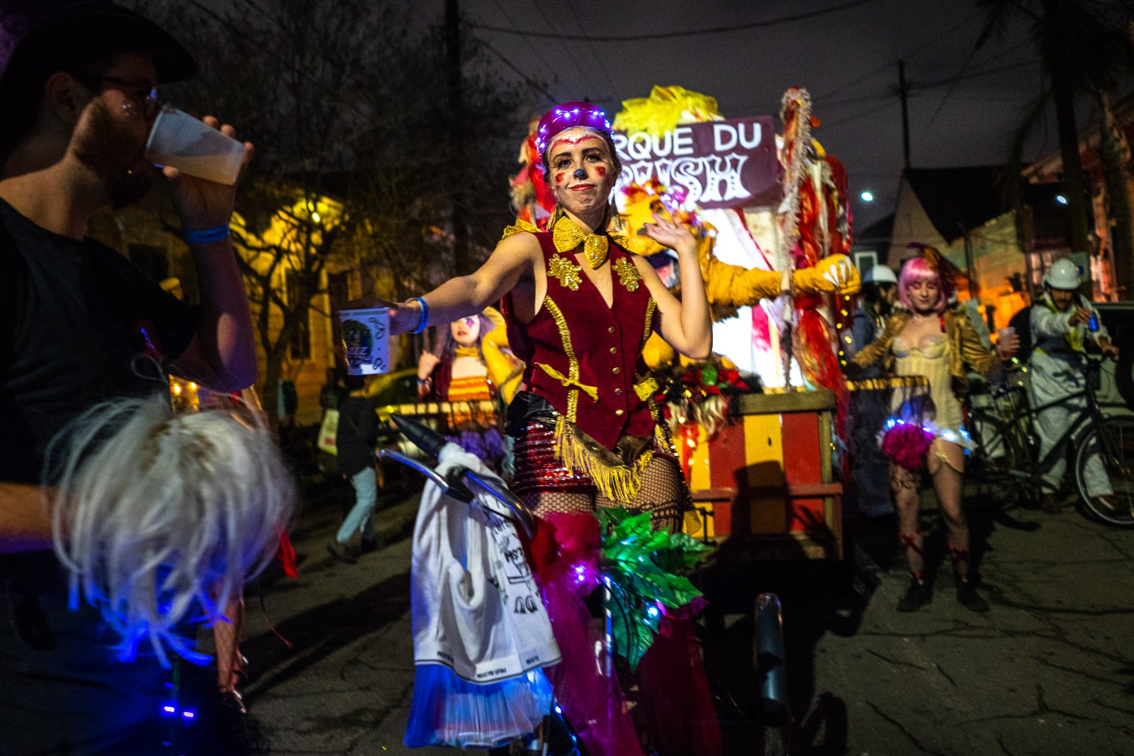 Girl cycling Krewe of Full Bush parade float in the Krewe Boheme Mardi Gras parade in New Orleans
