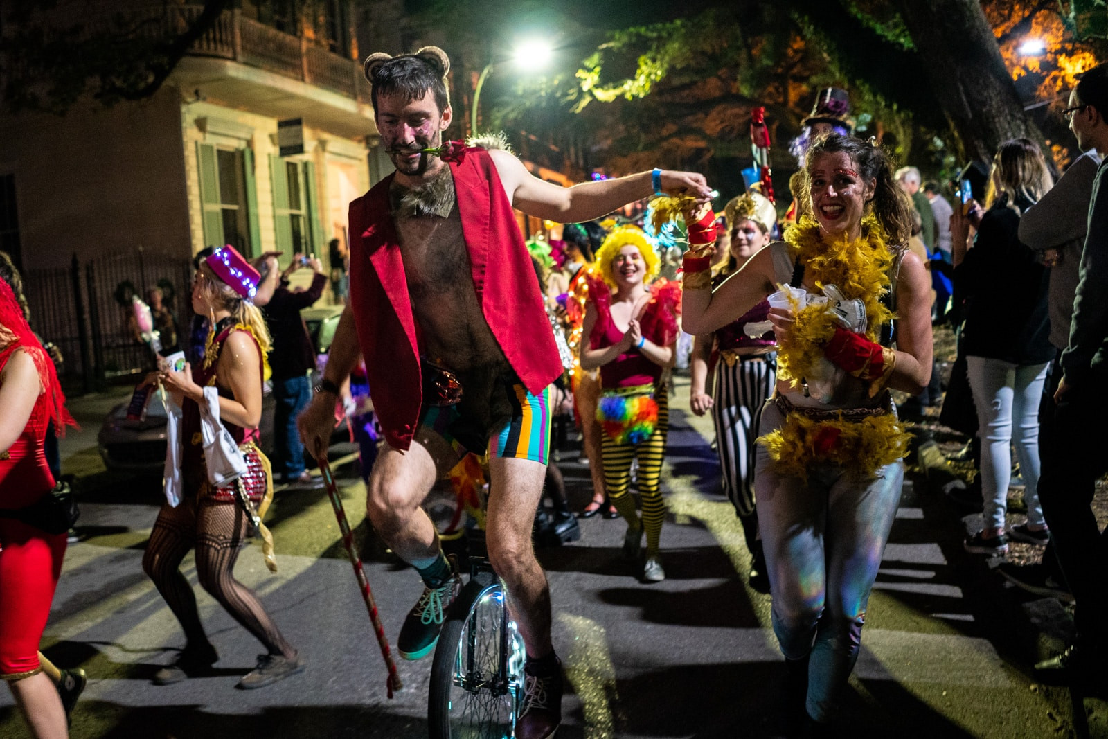 Boy riding a unicycle in the Krewe Boheme Mardi Gras parade in New Orleans