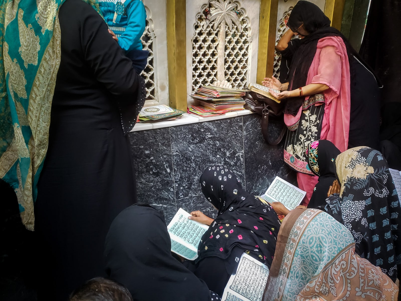 Interesting things to do in Lahore, Pakistan - Local women reading the Quran and praying at the shrine of Bibi Pak Daman