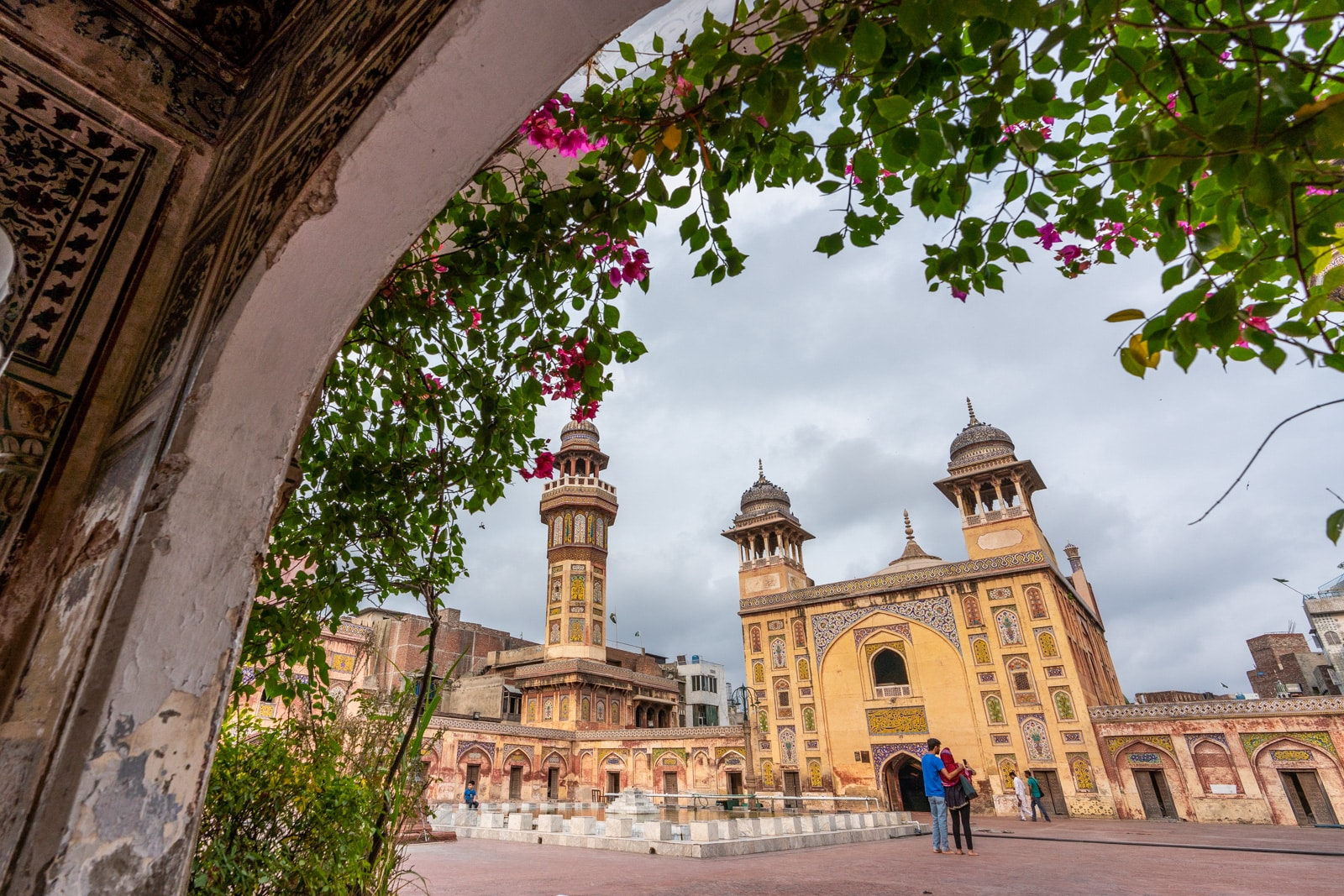 Wazir Khan mosque in Lahore through a flower lined archway