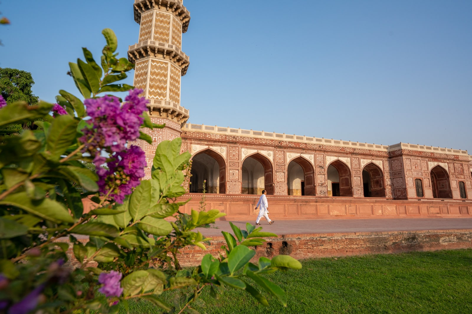 Day trips from Lahore, Pakistan - Man in a white salwar kameez walking at Jahangir's Tomb on the outskirts of Lahore