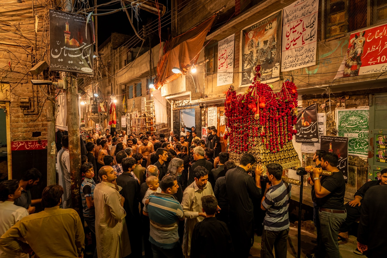 Unique things to do in Lahore, Pakistan - Shia Muharram procession at night in the Walled City of Lahore, Pakistan