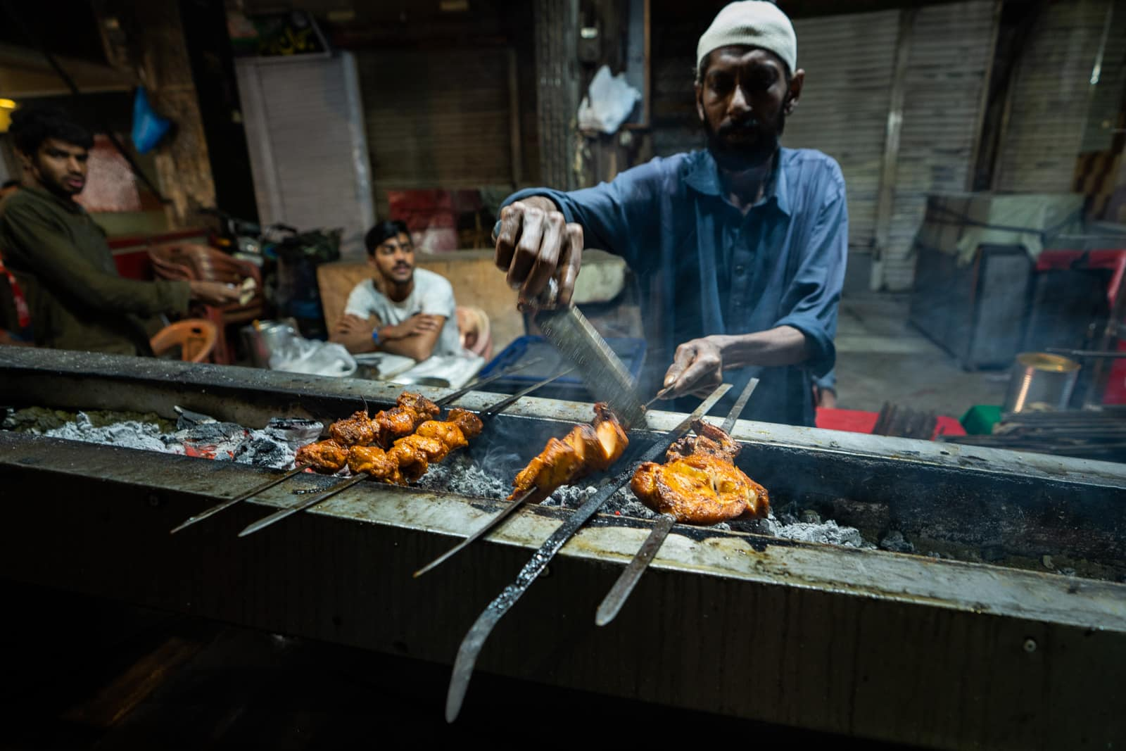 Unique things to do in Lahore - Kebabs cooking in the Walled City of Lahore