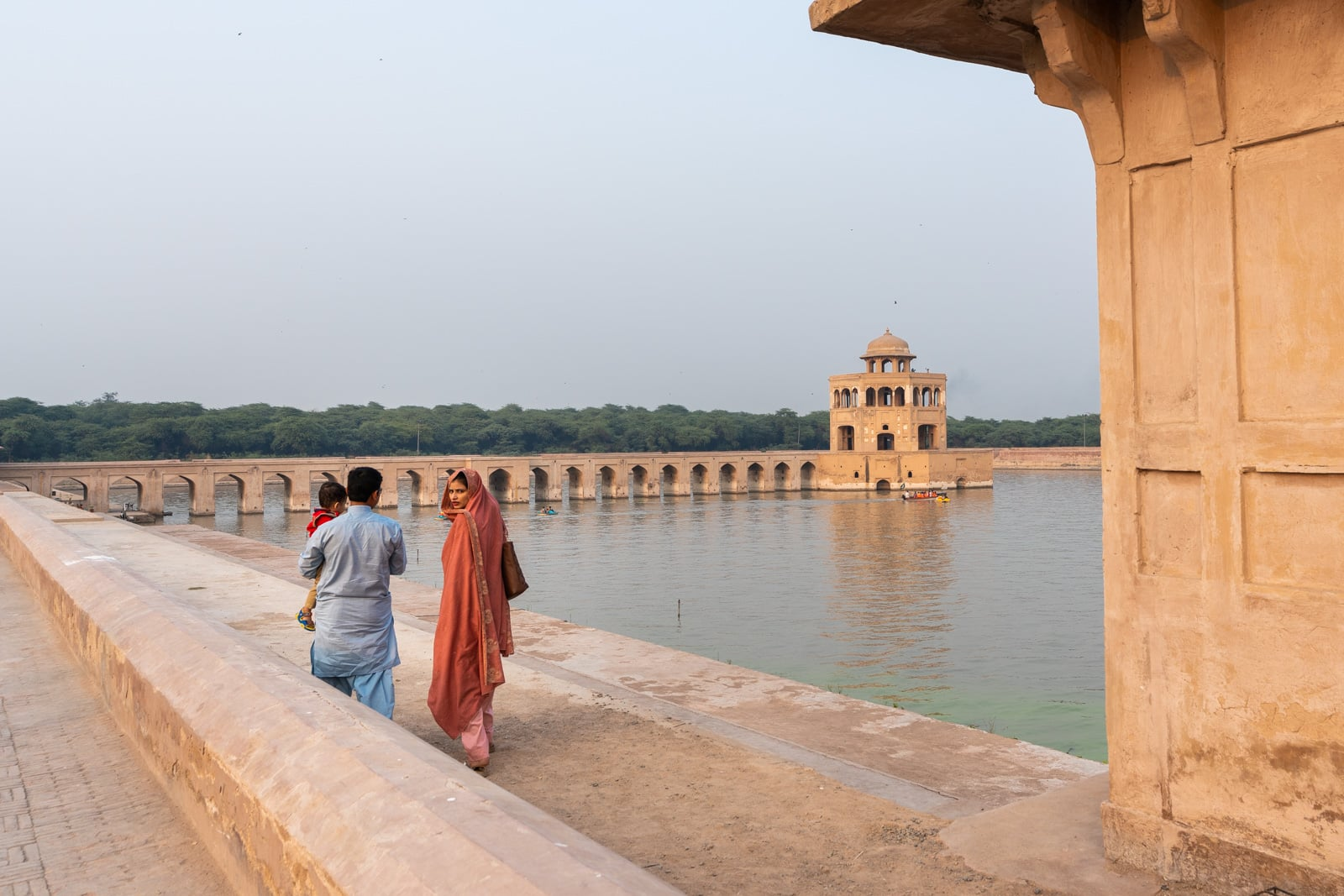 Interesting day trips from Lahore - A family walking at Hiran Minar monument in Sheikhpura, Pakistan