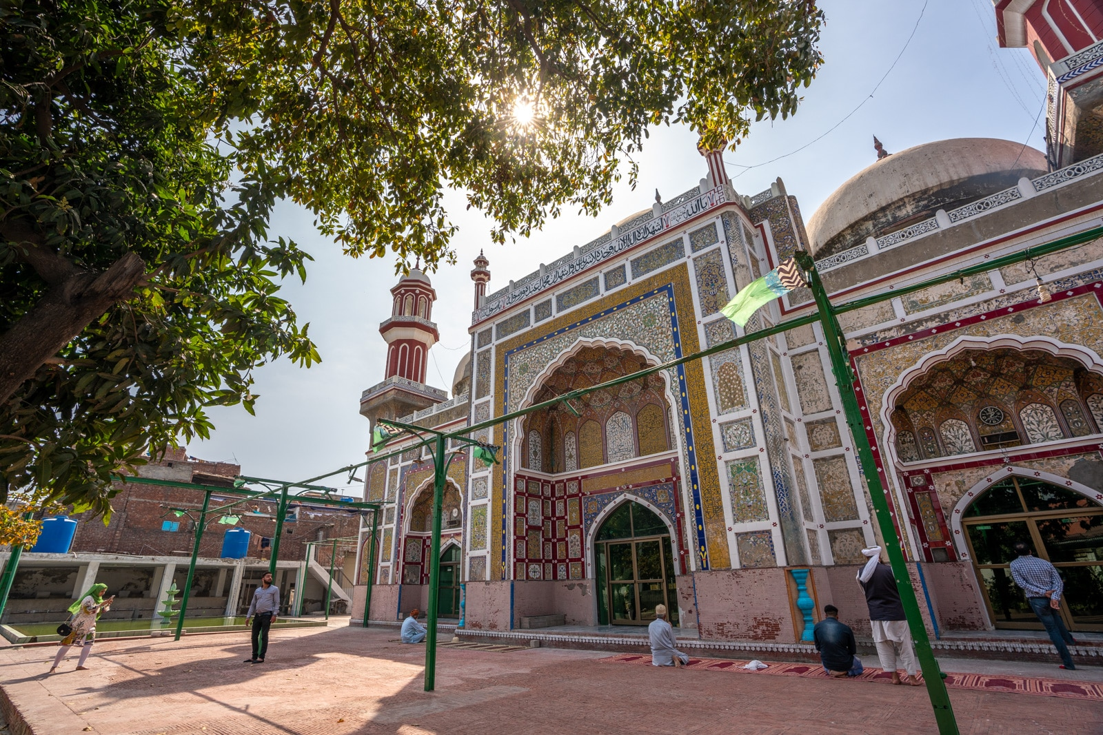Interesting things to do in Lahore, Pakistan - Sunlight coming through trees at the Dai Anga Mosque in Lahore, Pakistan